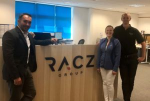 (l-r) Mike Racz with COO Laura Tarran, and Operations Manager Stephen Winspear in the reception of the new Racz Group office at Wynyard Business Park.